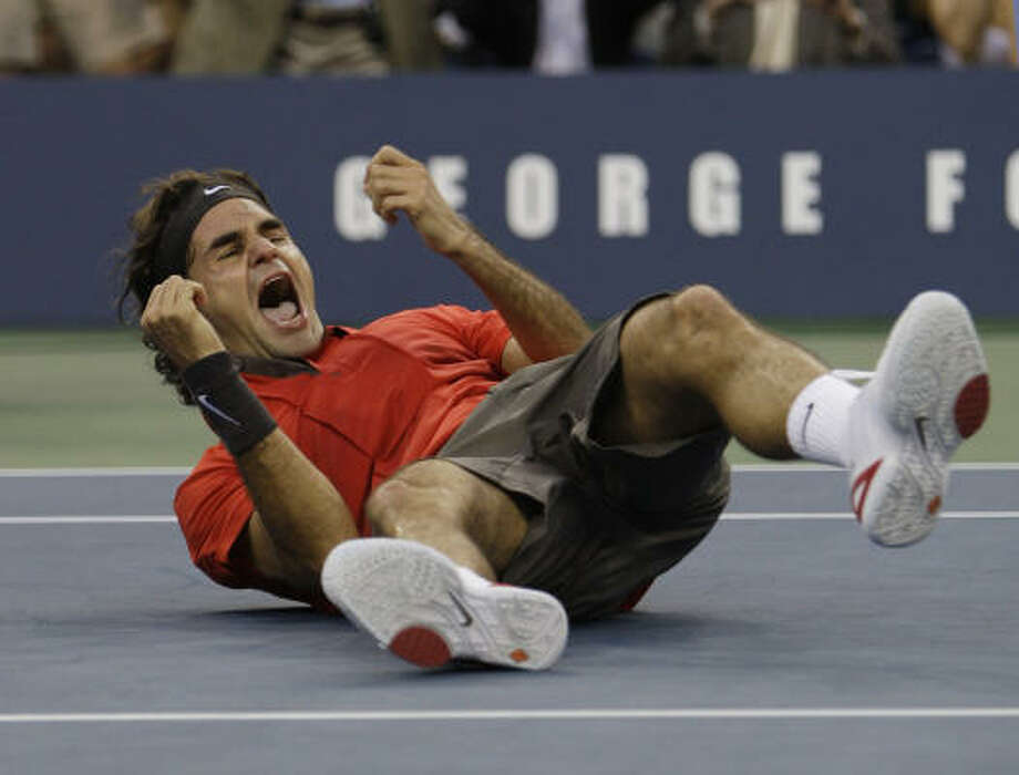 Roger Federer of Switzerland beats Andy Murray of Britain by a score of 6-2,7-5,6-2 to win the men's finals championship match at the U.S. Open. Photo: Charles Krupa, AP
