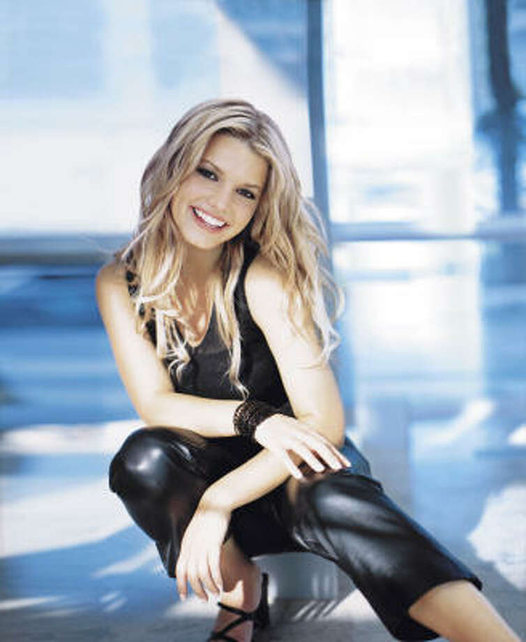 Dallas native Jessica Simpson in a promotional picture for her 1999 debut album, Sweet Kisses. Photo: Courtesy Photo