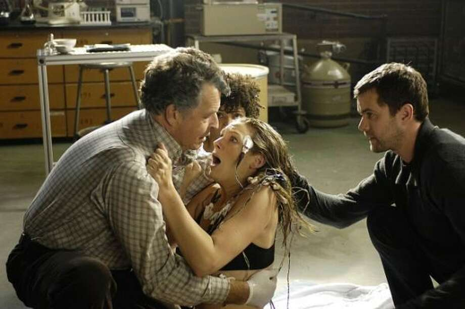An unlikely trio (played by John Noble, from left, Anna Torv and Joshua Jackson) uncovers a deadly mystery involving a series of unbelievable events and realizes they may be part of a larger, more disturbing pattern that blurs the line between the possible and the impossible on Fringe. Photo: Ben Mark Holzberg, Fox