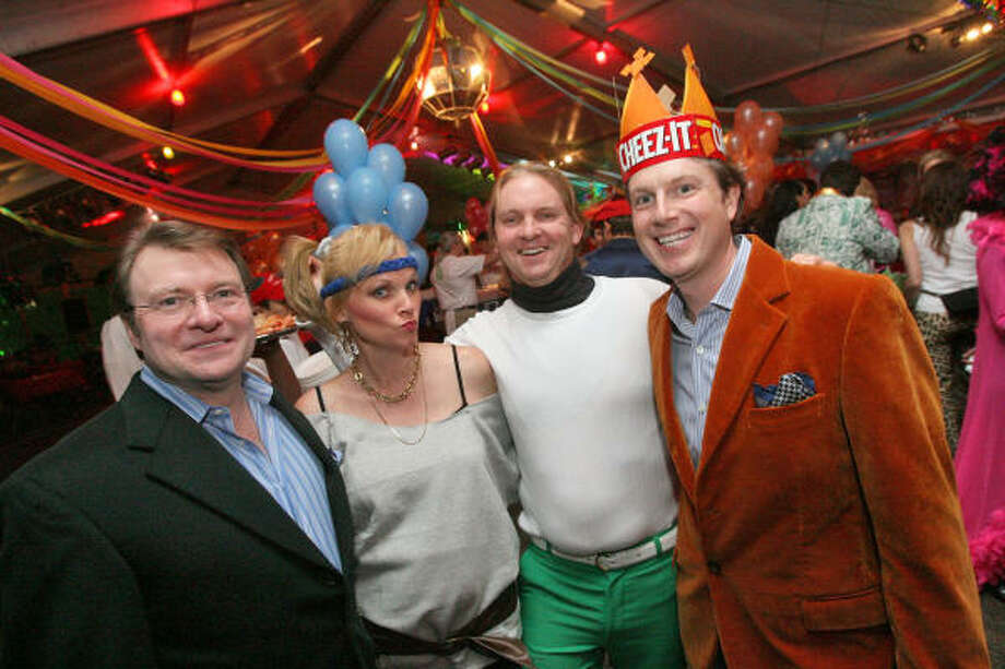 Bill Caudell, from left, Gretchen and Andrew McFarland, and Randy Powers raised the roof at the Ragin Cajun where they chaired the Cheese Ball, benefiting Glasstire and the Fresh Arts Coalition. Photo: Bill Olive, For The Chronicle