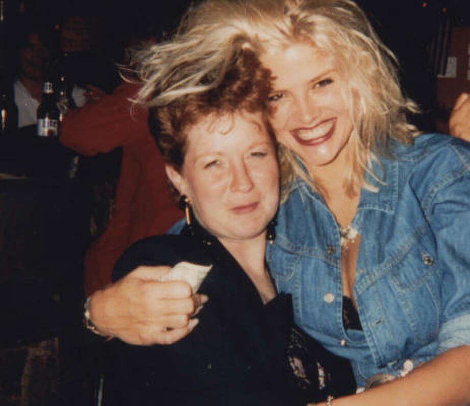 "Vickie Lynn Hogan sits on Sandi Powlege's lap during their ""first date"" at The Hill, a bar on Kuykendahl, in Houston, in 1991. Photo: Courtesy Sandi Powlege"