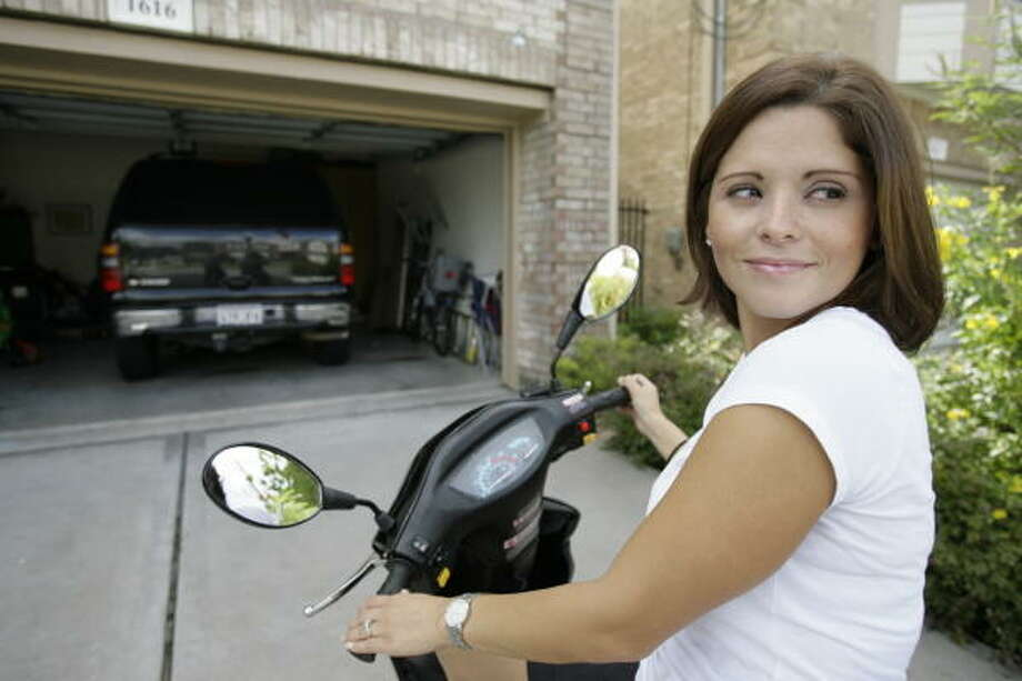 Maira Lenares replaced her Chevy Tahoe with a Roketa scooter to run errands around her neighborhood in Houston's West End. Photo: Meg Loucks, Houston Chronicle