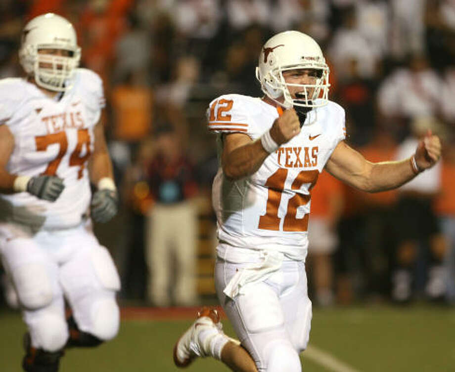 Texas quarterback Colt McCoy threw a first quarter touchdown to Quan Cosby. Photo: Victor Calzada, AP