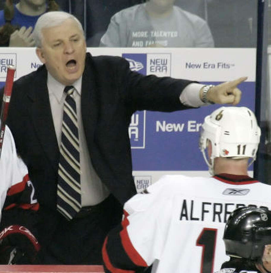 158d6e85d7d Senators coach Bryan Murray (right) gives instructions to Daniel  Alfredsson, who scored the