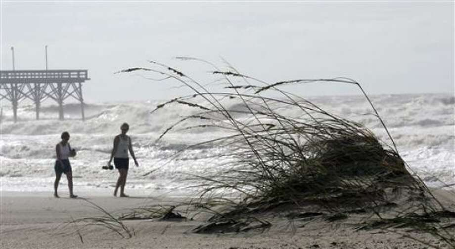 People look at beach road erosion at the east end of Ocean Isle Beach, N.C., on Saturday, Sept. 6, 2008 after Tropical Storm Hanna made landfall overnight in the area causing erosion and flooding problems. Photo: DAVE MARTIN, AP