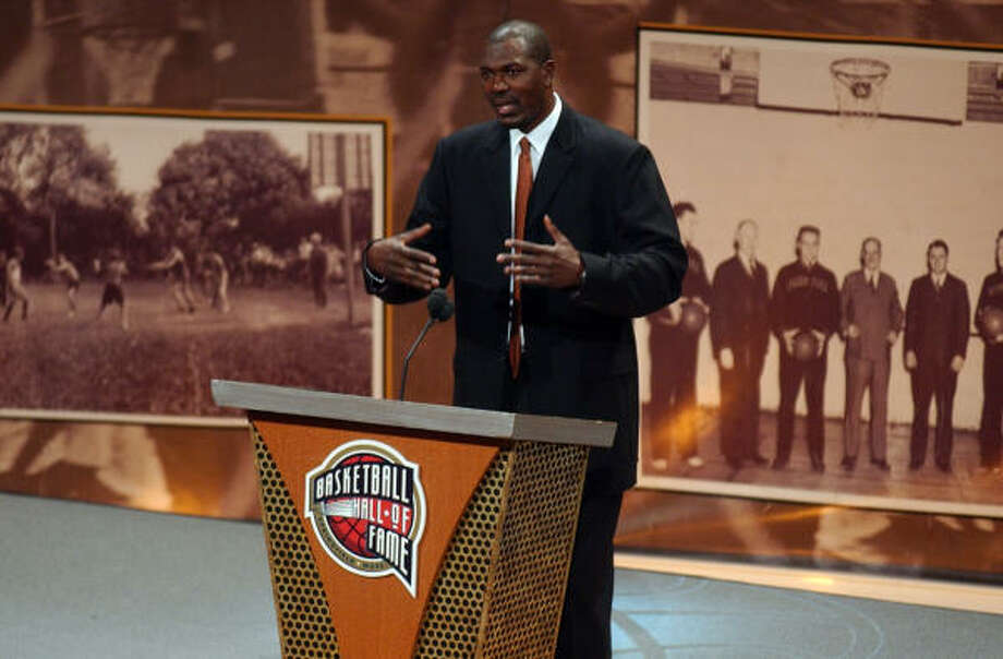 Former Rockets center Hakeem Olajuwon delivers his induction speech during Friday's ceremony at the Basketball Hall of Fame in Springfield, Mass. Photo: Nathan K. Martin, AP