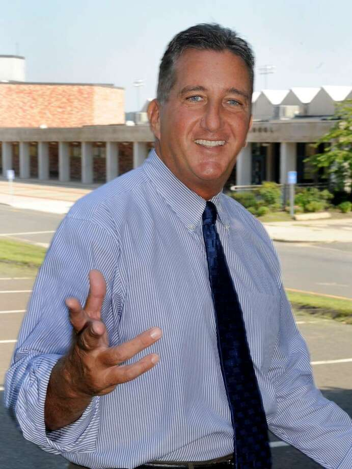 Bob Rossi, new principal, talks outside Danbury High on tuesday. Photo: Michael Duffy / The News-Times