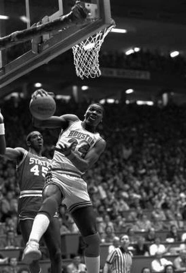 Hakeem Olajuwon, who established himself as a big-time player at the University of Houston, pulls down a rebound in the 1983 NCAA championship game against North Carolina State. UH lost 54-52. Photo: Associated Press