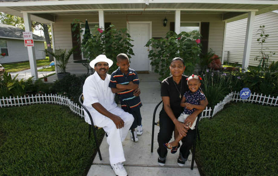 The Livers family, who relocated to Houston after Katrina, pose in front of their Habitat for Humanity home. Photo: Sharon Steinmann, Chronicle