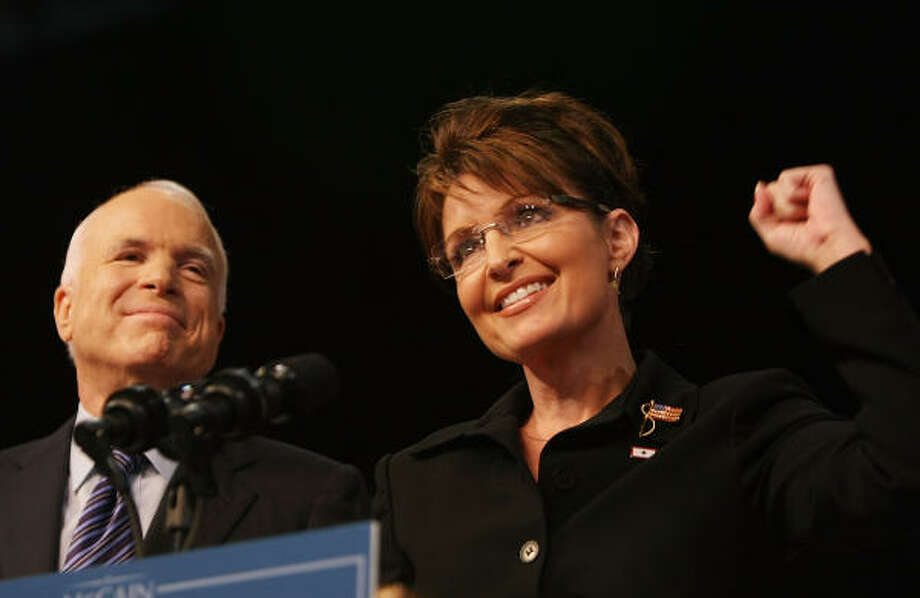 John McCain stands with Alaska Gov. Sarah Palin onstage at a campaign rally Friday in Dayton, Ohio. McCain announced Palin as his vice presidential running mate at the rally. Photo: Mario Tama, Getty Images