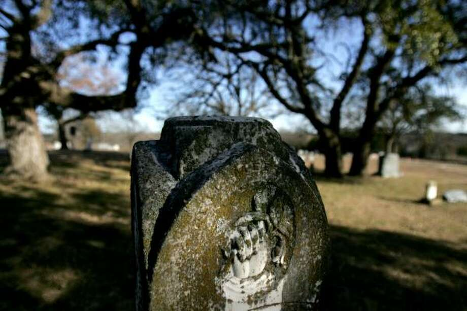Legend has it that the alien grave in Aurora lies underneath the bent arm of an old tree, far left, in the Aurora Cemetery. Requests to exhume the body in the past have been denied by the cemetery board. Photo: COURTNEY PERRY, FOR THE CHRONICLE