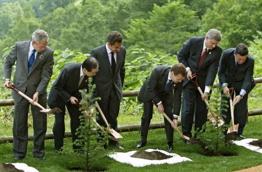 July 2008: Leaders of Group of Eight take shovels to plant trees commemorating the G8 summit in Toyako, Japan. Photo: DMITRY ASTAKHOV, AP