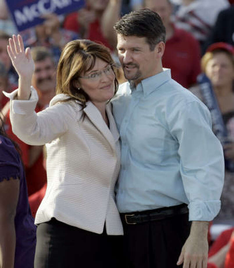 In her current role as governor of Alaska, Palin and her husband Todd say that they have shared parenting responsibilities. Photo: Jeff Roberson, AP