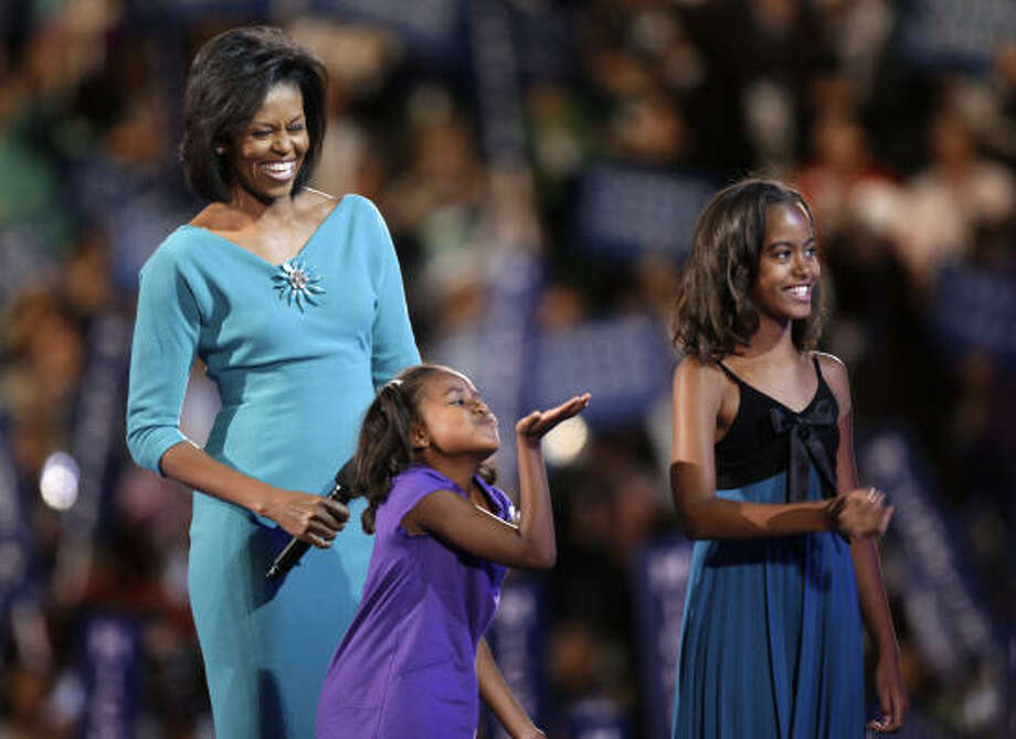 Democratic presidential candidate Barack Obama's wife, Michelle, is mother to their two girls, Malia and Sasha. Photo: Charlie Neibergall, AP