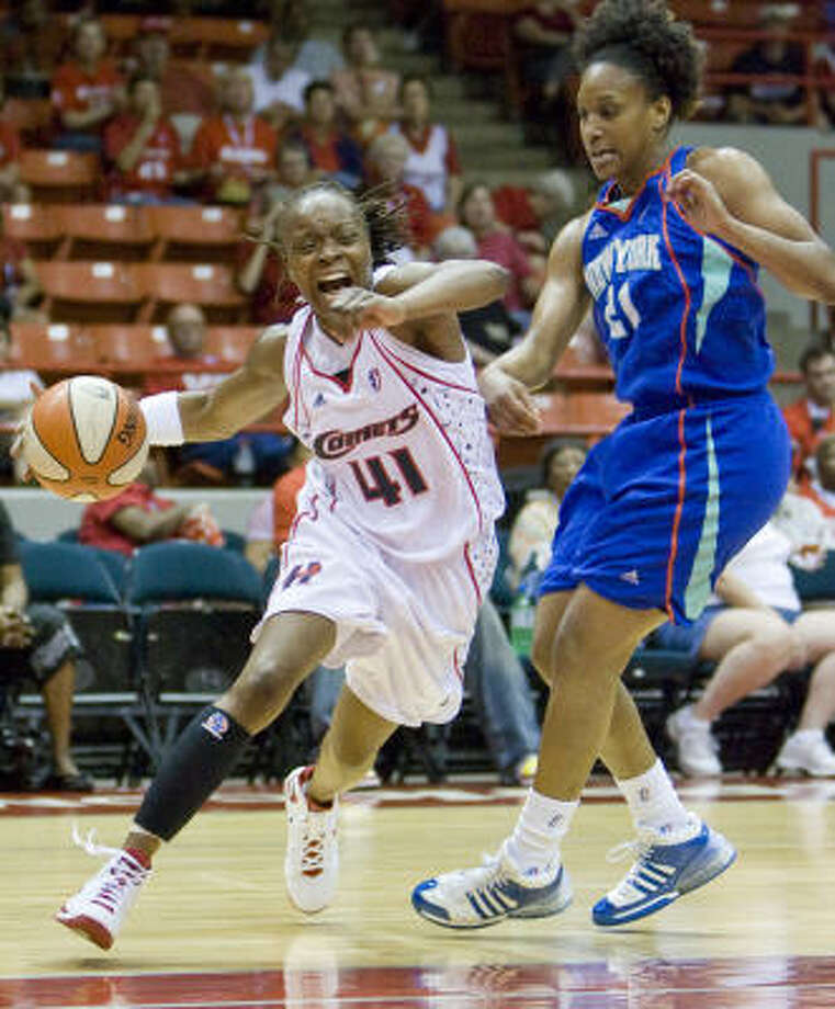 Houston Comets guard Shannon Johnson drives around New York Liberty guard Loree Moore in the first half as the Houston Comets played the New York Liberty. Photo: Steve Campbell, Houston Chronicle