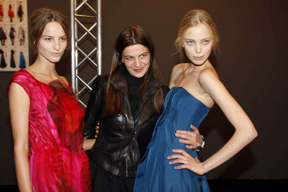 Designer Ivana Omazic, center, poses backstage with models at the most recent Celine fashion show during Paris Fashion Week. Photo: Eric Ryan, Getty Images
