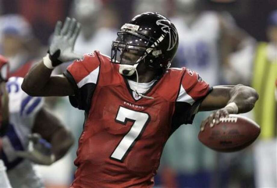 Michael Vick could be in a lot more trouble than any defensive lineman has caused him. Photo: AP