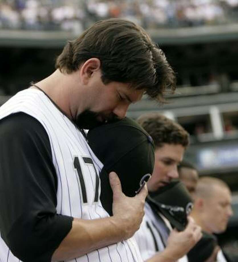 Members of the Colorado Rockies pay respects to Mike Coolbaugh before their game against San Diego on Monday night. Photo: DAVID ZALUBOWSKI, ASSOCIATED PRESS