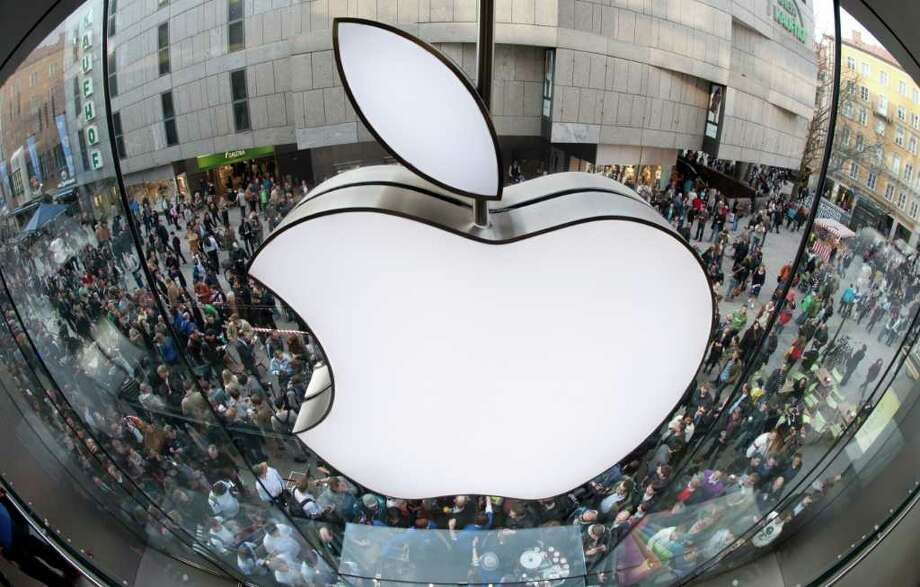 FILE - In this March 25, 2011 file photo, customers wait outside the Apple store in Munich before the start of sales of the iPad2. Investors seem to think you want an iPad more than oil, as Apple Inc. became the most valuable company in the United States, surpassing Exxon Mobil Corp. on Wednesday, Aug. 10, 2011. (AP Photo/dapd, Lukas Barth, File) Photo: Lukas Barth