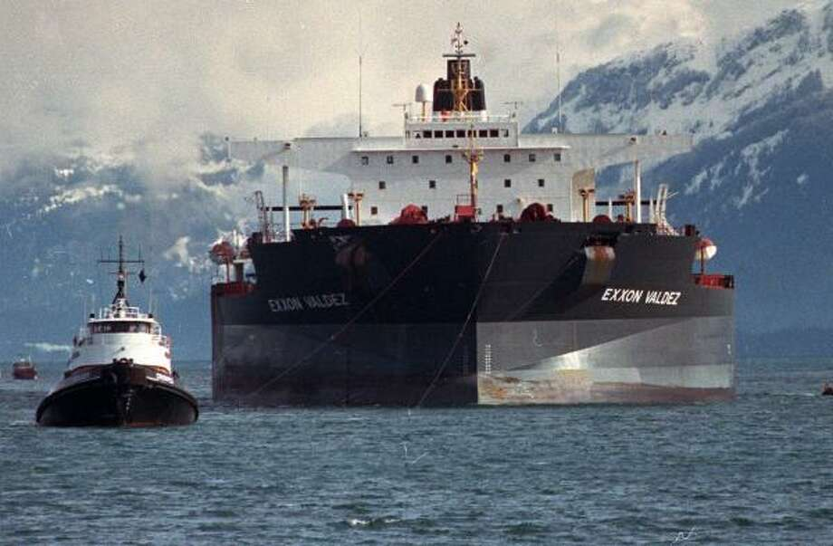 Tugboats pull the crippled Exxon Valdez oil tanker through Prince William Sound following the spill of 11 million gallons of oil in April 1989. The Supreme Court will hear the case of punitive damages. Photo: Rob Stapleton, ASSOCIATED PRESS FILE