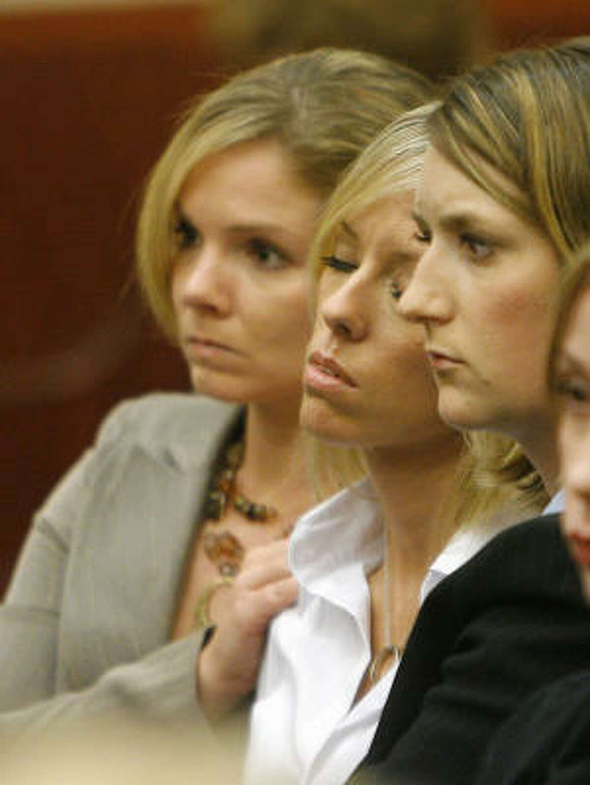 Heather Scott Temple, center, is comforted by friends during final arguments in the punishment phase of the trial of her husband, David Temple.