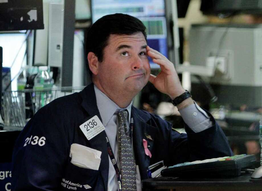Specialist Stephen Steinthal works at his post on the floor of the New York Stock Exchange Wednesday, Aug. 10, 2011. (AP Photo/Richard Drew) Photo: Richard Drew