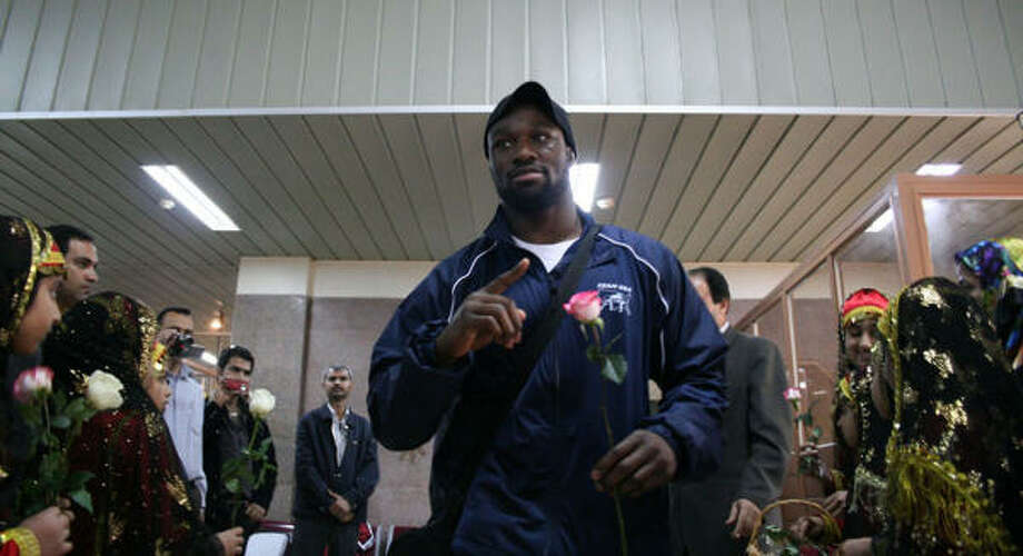 American freestyle wrestler Muhammed Lawal and his teammates arrive Tuesday in Bandar Abbas, Iran. Photo: AP