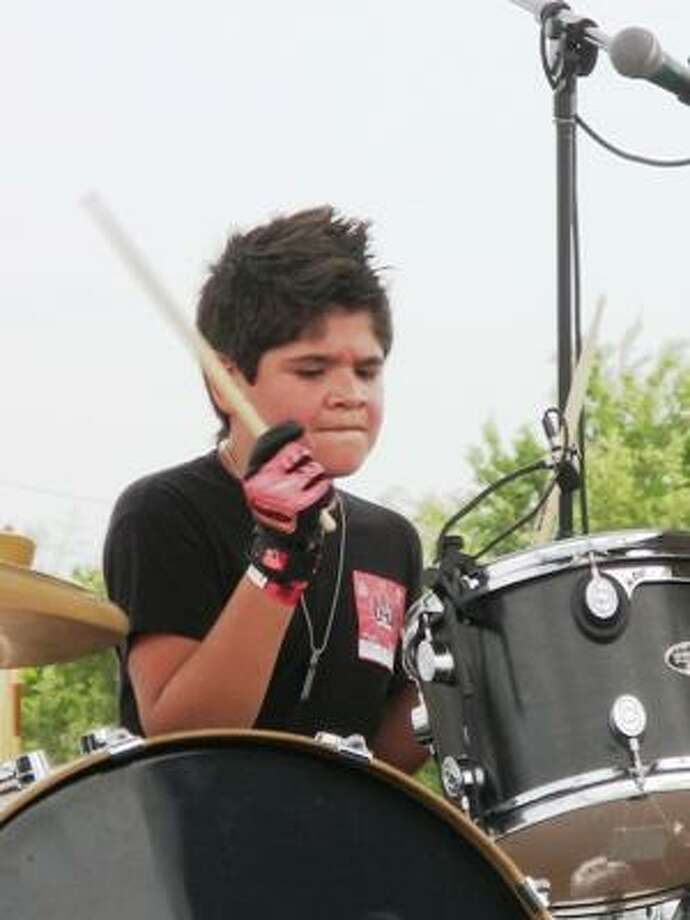 Out of Reach drummer Christian Chavez. Photo: Joey Guerra, Chronicle