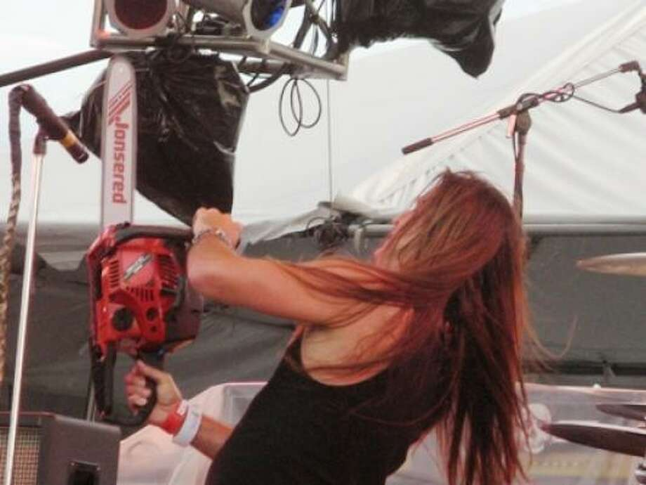 Jackyl singer Jesse James Dupree on chainsaw. Photo: Joey Guerra, Chronicle