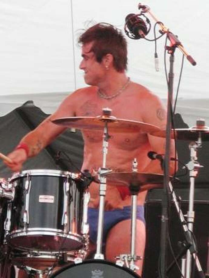 Jackyl drummer Chris Worley decides not to deal with the heat. Photo: Joey Guerra, Chronicle