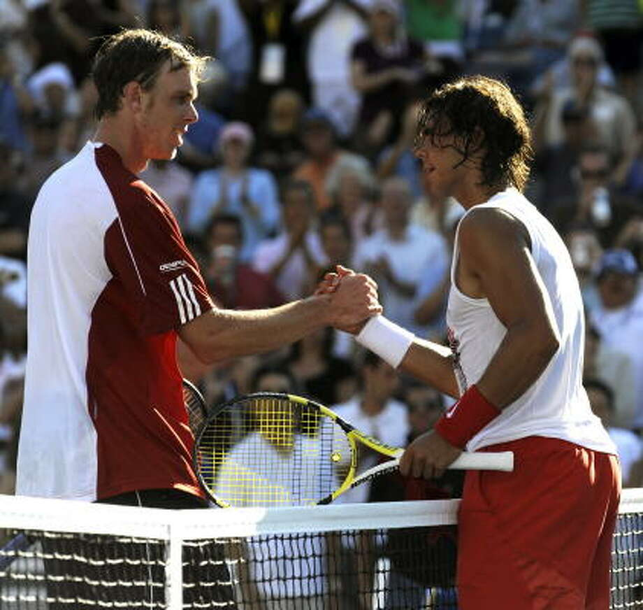 World number one Rafael Nadal (right) of Spain shakes hands with Sam Querrey of the U.S. at the net after defeating him at the USTA National Tennis Center. Nadal won 6-2, 5-7, 7-6 (7/2), 6-3. Photo: TIMOTHY A. CLARY, AFP/Getty Images
