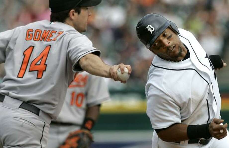 Gary Sheffield is unsuccessful in avoiding the tag from the Orioles' Chris Gomez during a rundown. Photo: PAUL SANCYA, ASSOCIATED PRESS