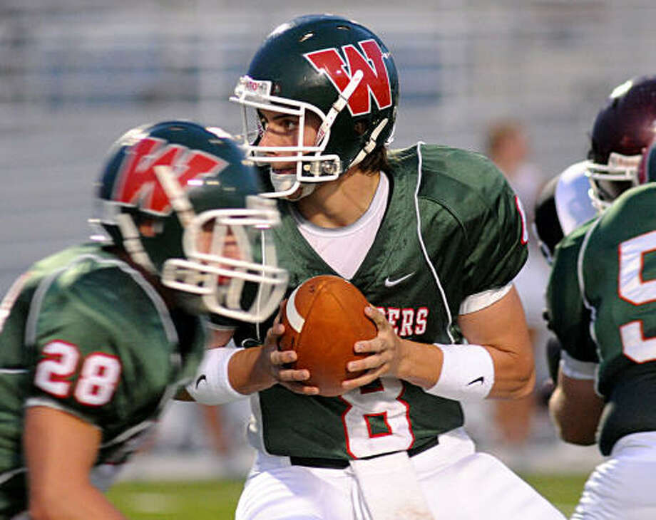 THE WOODLANDS 42, CY-FAIR 0:The Woodlands Andy McCloud hands off the ball during the opener against Cy-Fair in the new Woodforest Bank Stadium on Aug. 29. Photo: David Hopper, For The Chronicle
