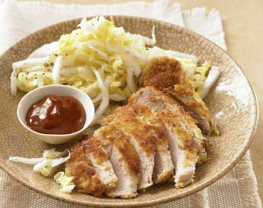 The Japanese bread crumbs bolster the crunch in Panko-Crusted Pork Chops. They pair well with Napa Salad. Photo: CLIVE STREETER, EVERYDAY FOOD