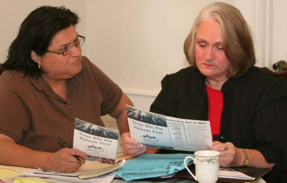 Linda Morales, left, union representative for the California Nurses Association, goes over material for a National Nurses Organizing Committee meeting with Joanne Guimond-Thompson, a Houston nurse. Photo: GARY FOUNTAIN, FOR THE CHRONICLE