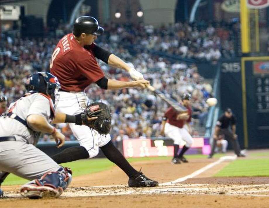 Houston's Hunter Pence, second from left, singles to center field in the second inning, scoring Lance Berkman. Click here for game statistics. Photo: Bob Levey, AP