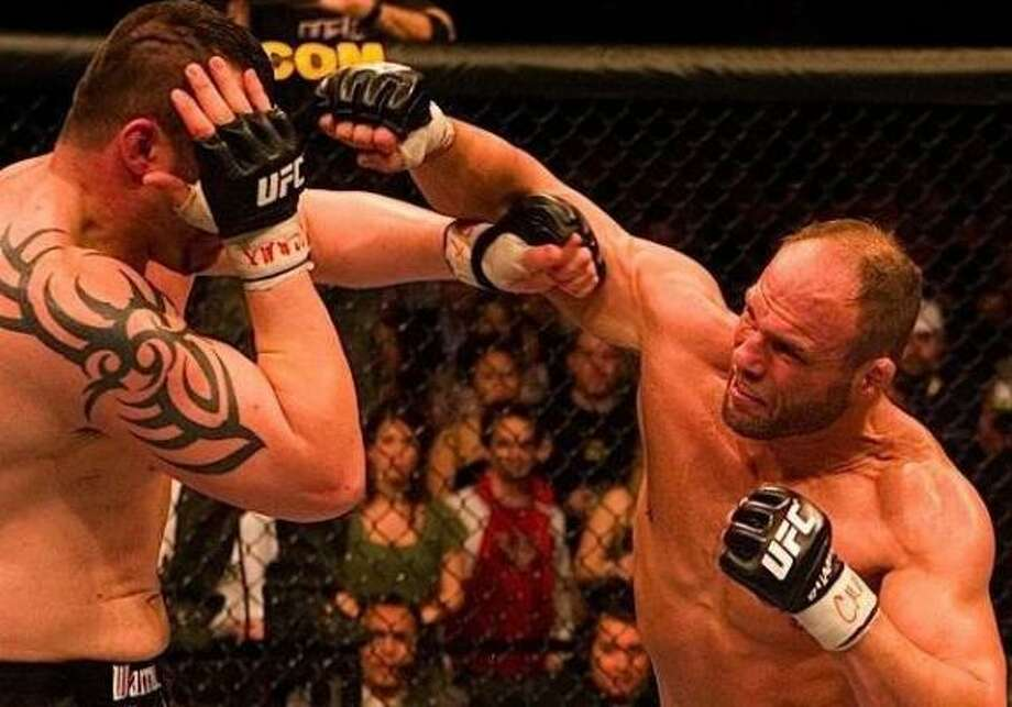 Randy Couture (right) was in fine form during his victory over Tim Sylvia at UFC 68. Photo: COURTESY MMA