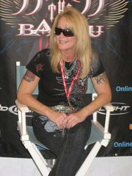 Lita Ford relaxes backstage.