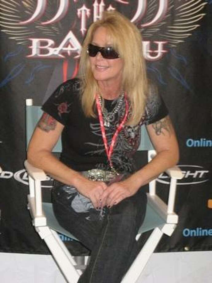 Lita Ford relaxes backstage. Photo: Joey Guerra, Chronicle