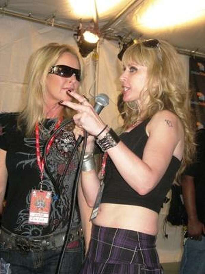 Rock of Love 2 winner, Ambre Lake, right, interviews Lita Ford for TMZ. Photo: Joey Guerra, Chronicle