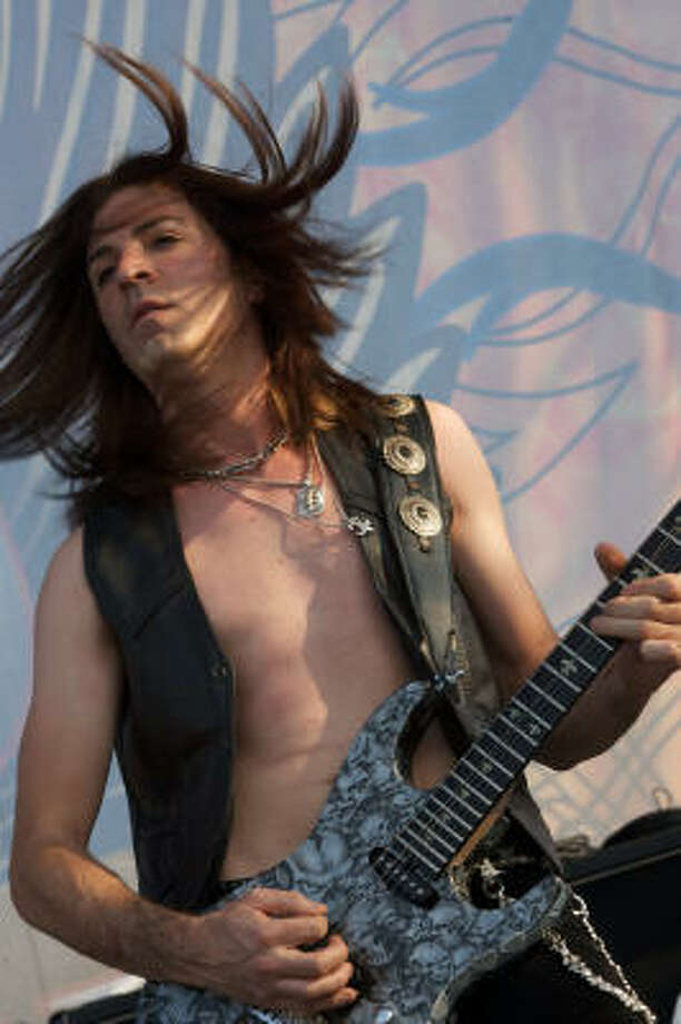John Levin of Dokken performs. Photo: Bill Olive, For The Chronicle