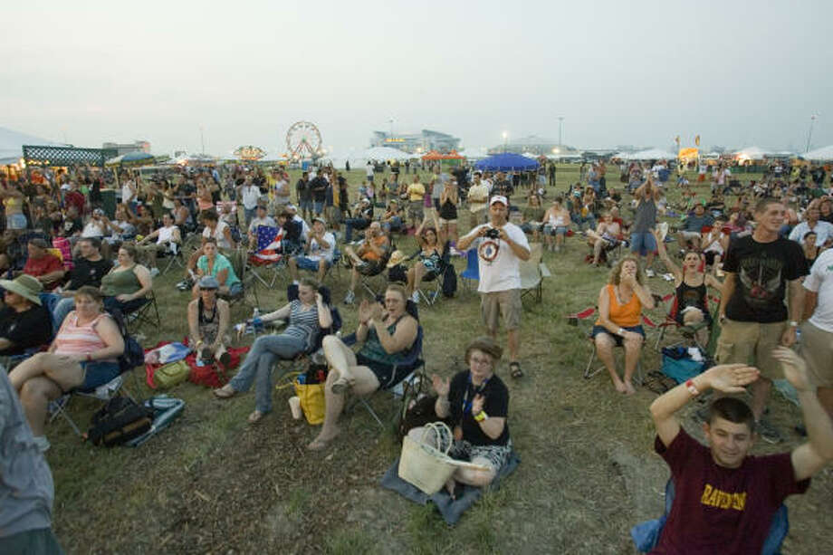 Rock fans watch Lita Ford from the field. Photo: Bill Olive, For The Chronicle