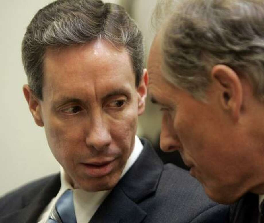 Warren Jeffs confers with his attorney Richard Wright during Jeffs' trial in St. George, Utah, on Monday. Photo: DOUGLAS C. PIZAC, AFP/Getty Images