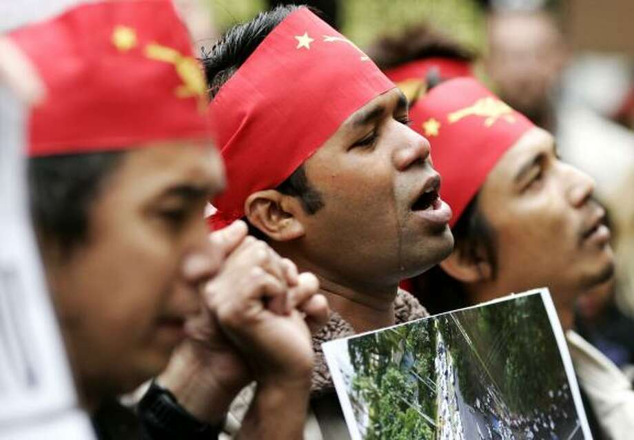 A student protest song brings a demonstrator to tears Thursday outside the Myanmar Embassy in London. Photo: SANG TAN, ASSOCIATED PRESS