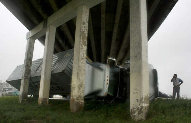 A truck blown off the highway by Hurricane Gustav sits under a bridge in Los Palacios, Cuba. Photo: Javier Galeano, Associated Press