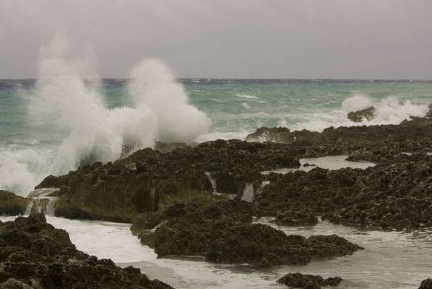 Friday, Aug. 29: Waves crash along the shoreline as the Gustav storm system approaches in West Bay on Grand Cayman Island. Photo: Brennan Linsley, AP