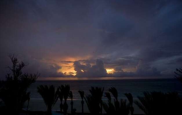 Rain clouds form off Seven Mile Beach on Grand Cayman Island seen from Westin Casuarina Resort and Spa at sunset as the Gustav storm system approaches. Photo: Brennan Linsley, AP