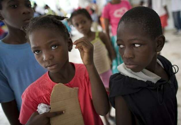 Evacuees from Hurricane Gustav take shelter at a school in Petit Goave, Haiti. Photo: Ariana Cubillos, AP