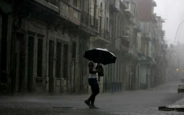 A man makes his way through heavy rains caused by the approaching Gustav in Havana Aug. 26. Photo: Javier Galeano, AP