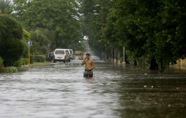 A man walks through a flooded street during heavy rains caused by the approaching of Gustav in Havana Aug. 26. Photo: Javier Galeano, AP